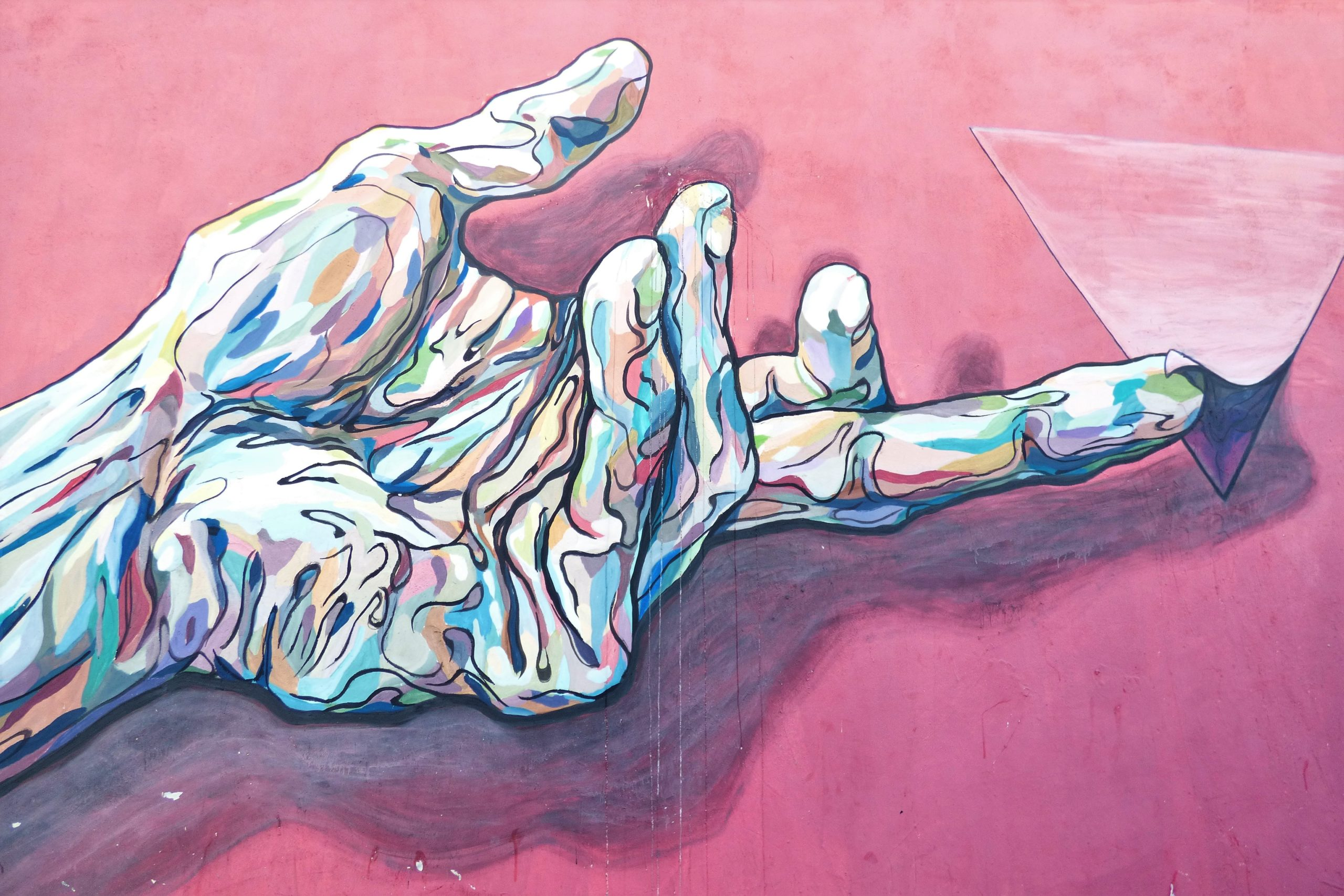hand holding pyramid painting
